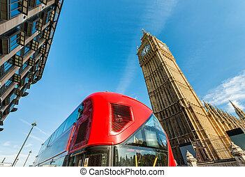 Classic red bus in London with Big Ben on background