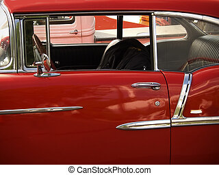This is a shot of a shiny candy apple red classic car.