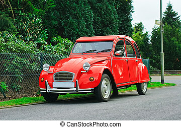 Classic red retro car - French red Citroen 2 cv parked in a...