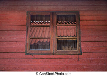 Classic retro vintage window on wall of wooden hut in Chaiyaphum, Thailand