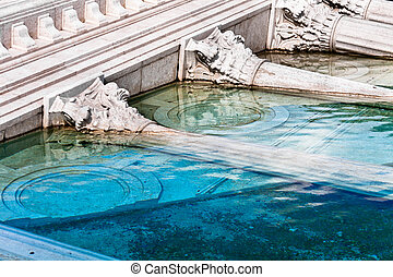 classic roman monument sunk in water