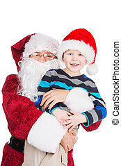 Classic Santa Claus hugging little boy. Standing ad smiling isolated over white background
