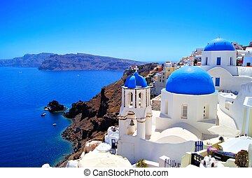 Classic Santorini scene with famous blue dome churches,...