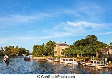 Classic small cruise boats on the famous Dutch river Vecht...