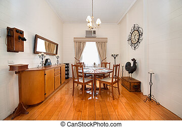 Classic style dining room with polished wooden floors, and...