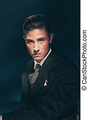 Classic stylish vintage man in suit and tie. Hair combed...