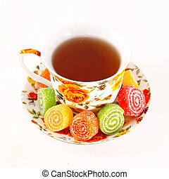 Classic tea cup with red and orange flowers
