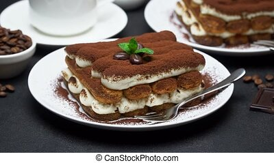 Classic tiramisu dessert, cup of coffee, sugar and milk on ...