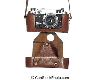 Classic vintage camera in a leather cover, isolated on white background