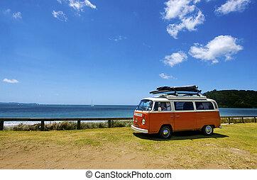 TAIPA - JAN 19: Classic 1958 Volkswagen Kombi Van during road trip parks on Taipa bay on January 19 2013 in Taipa, New Zealand.