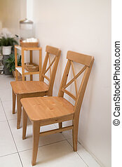 Classic Wooden Chairs In Coffee Shop Interior
