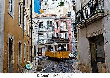 Classic Yellow Tram in Alfama quater in Lisbon, Portugal