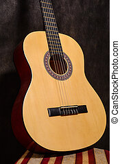 Classical acoustic guitar on a stool vintage