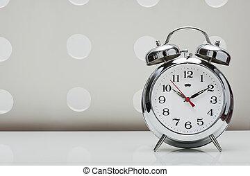 classical alarm clock on vintage background