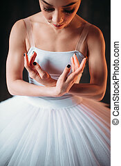 Classical ballet dancer body in white dress