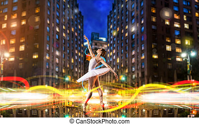 Classical ballet dancer dancing on city road