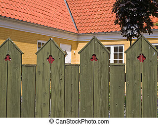 details of classical traditional design green wood fence