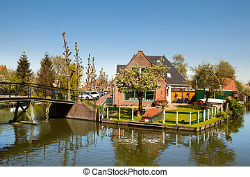 Classical Dutch landscape - Brick Dutch house on the bank of...