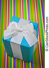 classical giftbox on colored striped background