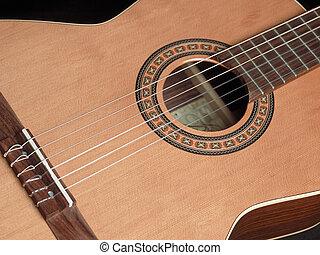 Classical guitar - Closup image of a classical guitar.