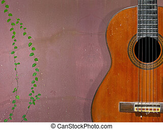 Classical guitar with nylon strings on grunge wall