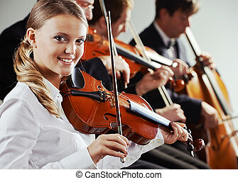 Classical music - Musicians in concert, beautiful female...