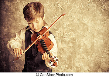 classical music - Freckled nine year old boy playing the...