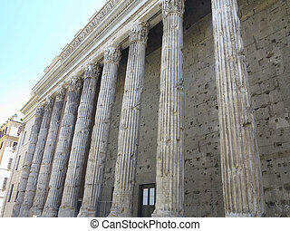 Classical old and worn out columns at the front of the pantheon in Rome