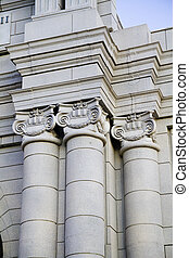 Classical style columns in ionic order on exterior of modern building.