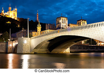 Lyon over the Saone river at cloudy night