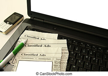 Classified Ads - classified section of the newspaper on a...