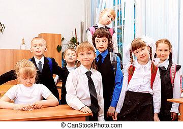 classmates - Happy children in a class at school.