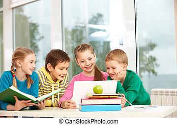 Classmates in school - Portrait of smart schoolgirls and...
