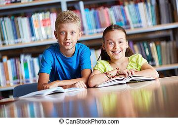 Classmates - Portrait of cute schoolchildren looking at...