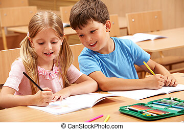 Classmates - Portrait of two schoolchildren sitting by one ...