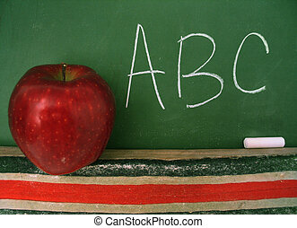 Classroom chalkboard with apple.