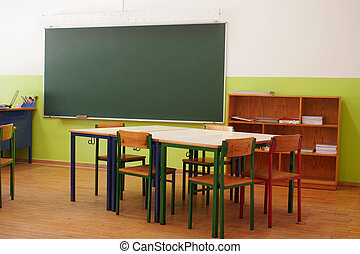 classroom - image of a classroom with desks arranged in...