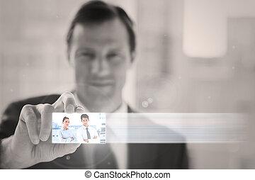 Classy businessman presenting digital interface
