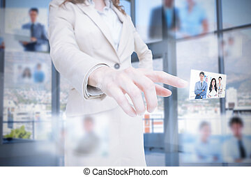 Classy businesswoman presenting coworkers pictures on...