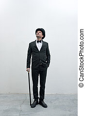 Classy gentleman standing on white background and concrete ...