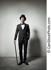 Classy gentleman with bowler hat and cane looking...