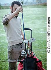Classy golfer choosing a club