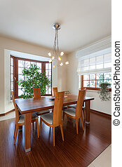 Classy house - dining room with brown wooden table