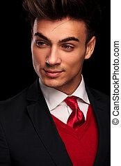 classy model in suit looking away