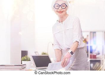 Classy senior businesswoman working in office