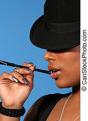 Beautiful & Classy African American woman smoking a cigarette.