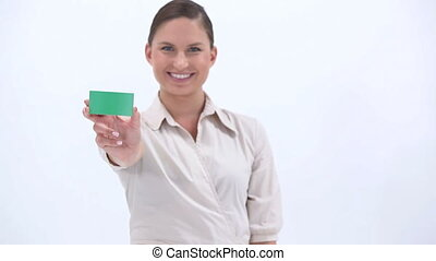 Classy woman showing a green card