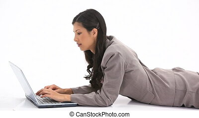 Classy woman using a laptop - Video of a classy woman using...