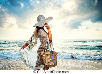 Classy young woman relaxing at the beach
