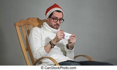 claus, casquette, jeu, jouer, téléphone, surprenant, santa, lunettes, ton, rouges, homme